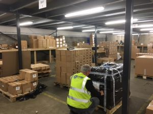 TPS Global warehouse team labelling pallets