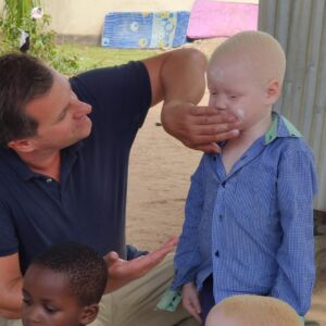 David at Westmark delivering Sunscreen to the African albino children